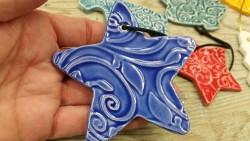 kifer-blue-star-ornament-in-hand
