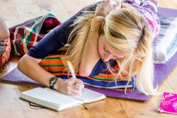 blond-yoga-woman-writing-in-journal